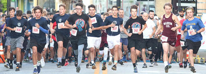 Runners take off at the finish line at the Farmers National Bank Pokey Pig 5K Run/Walk on Saturday at Ham Days.