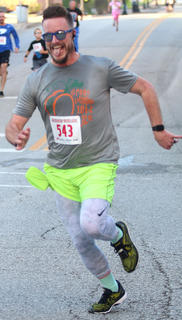 Ryan Shannon wags his tongue as he finishes strong at the Pokey Pig on Saturday at Ham Days.