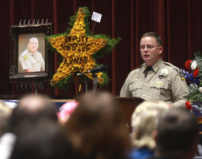 Marion County Sheriff Jimmy Clements speaks about Deputy Anthony Rakes during the funeral service Saturday afternoon at Marion County High School.