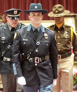 Honor guard members changed every 15 minutes to keep watch over Rakes casket prior to his funeral Saturday at Marion County High School.