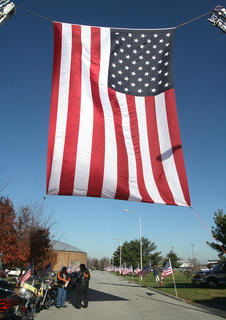 A large American flag filled an archway created by two fire trucks as the entrance to Marion County High School.