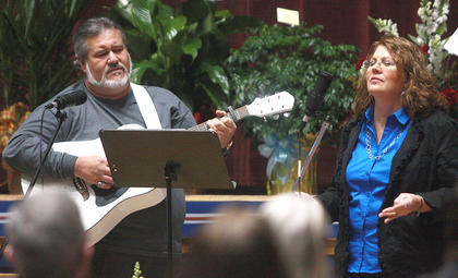 Gene Laferty and Michelle Rakes sing during the funeral for Deputy Anthony Rakes.