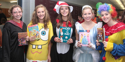 Share-A-Story Night was held Nov. 16 at Marion County High School to promote literacy, and several high school students helped with the event. Some of those volunteer students are, from left, Shellby Spalding (Harry Potter), Elyssa Holt (Spongebob Squarepants), Madison Cassidy (the Cat in the Hat), Anne Spalding (Cinderella) and Ann-Morgan Reynolds (Squirty the Clown).