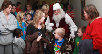 Adults and children alike around Santa at Lebanon Health and Fitness