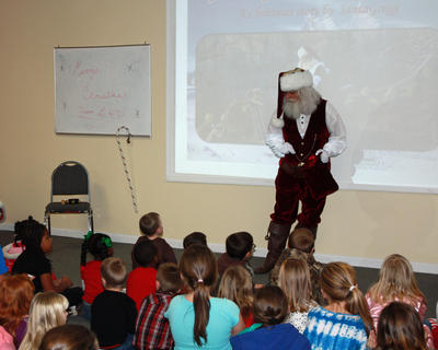 Children listen to Santa tell a story at Lebanon Health and Fitness.