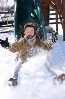 Sarah Mattingly took this photo of Jake Medley sliding into snow on Feb. 17.