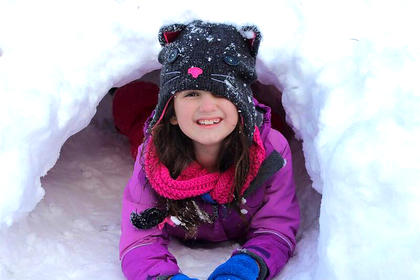 Kayton Shewmaker lays inside her very own igloo after the snow fall of on Jan. 24.