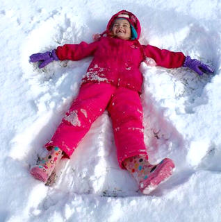 Kenlee Shewmaker makes a snow angel on Jan. 24.