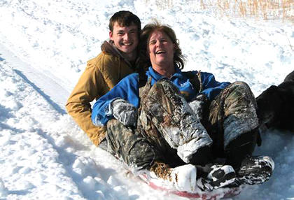 Renee Miles and Garrett Krenning have a blast sledding last week.