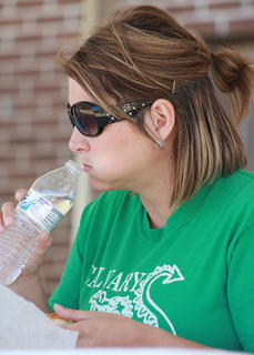 Hope Dougherty of Calvary Elementary School prepares to take a drink of water during the second heat.