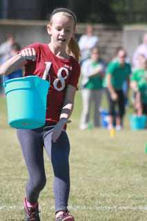 Cheyenne Brown of Glasscock Elementary prepares to dump her bucket of water.