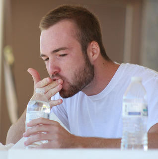 In the end, heat 4 winner Chase Lancaster polishes off his final bite moments before winning this year's ham biscuit-eating contest.