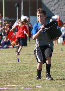 J.J. Essex of West Marion Elementary reaches the halfway point in his leg of the relay race.