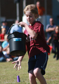 Shane Bartley prepares to dump the water out of his bucket for West Marion Elementary.