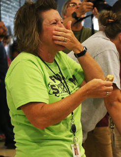 Michelle Miles feels the pain in the Marion County Country Ham Days annual Slop the Hogs contest.