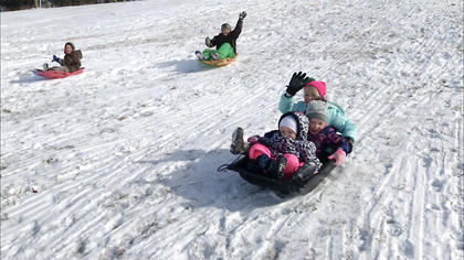 Pictured sledding are Easton Brussell, Jaxon Huff, Lillian Collopy, Adelyne Huff and Abigail Collopy.