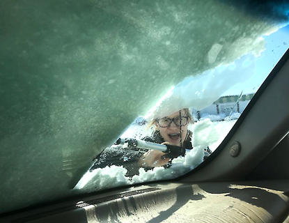 Delaney Hammond of Lebanon has some fun while clearing the windshield.