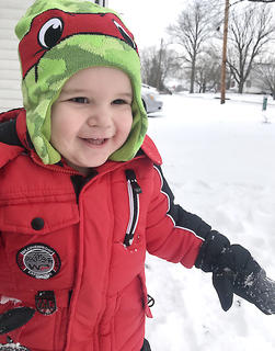 One-year-old Nolan Drake Salo plays in the snow with his daddy. His parents are Randy and Tiffany Salo.