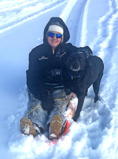 Briley Mudd and her dog Hunter play in the snow.