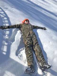 Brandon Estes makes a snow angel.