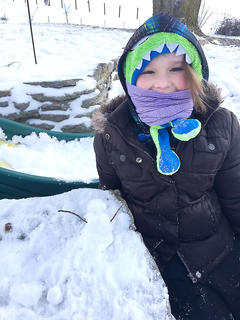 Pictured is Brittany Browning who attempted to make a snowman last week but the snow wouldn't cooperate.