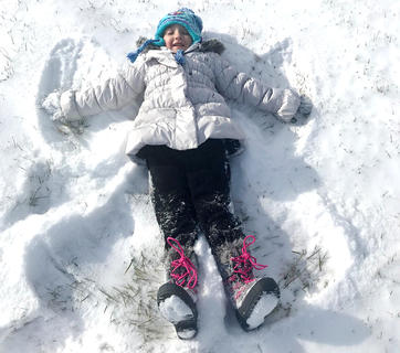 Kailyn Smith makes a snow angel.