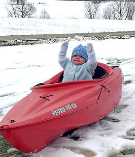 Michelle Culver said she couldn't find a sled for her one-year-old son, Logan, so they used a kayak instead. Now, that's resourceful!