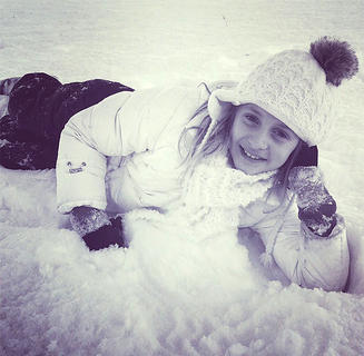 Bella Spalding poses for a photo in the snow.