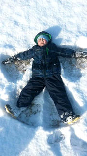 Brayden Spalding makes a snow angel.