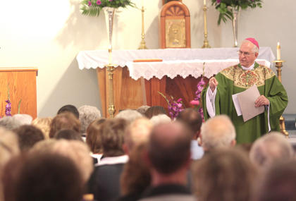 Rev. Joseph Kurtz, the archbishop of Louisville, delivers the homily during the anniversary Mass.