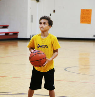 Gabriel Washington prepares to take his shot in the basketball contest at St. A's on Sept. 29. Gabriel won first place for his age division.