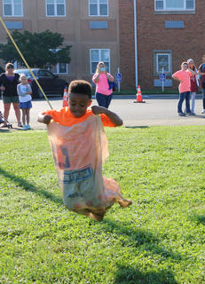 Darian Young catches major air in the sack race playground contest at St. A's on Sept. 29, before winning first place.