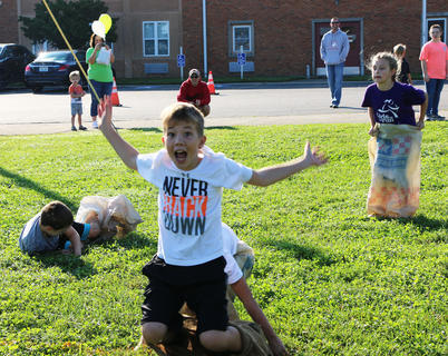 JR Mattingly takes a tumble in the sack race playground contest at St. A's on Sept. 29, but managed to win second place.