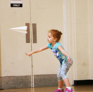 Kylie Reed throws her airplane in the paper airplane contest at St. A's on Sept. 29.