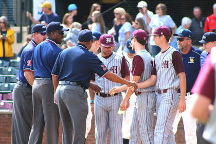 Head Coach Patrick Campbell and team captains Landon Russell and Andrew Spalding shake hands with the umpire crew at the pre-game plate conference.