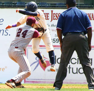 Shortstop Travis Wiser tags out Hazard's Andy Baker as he attempts to steal second base.