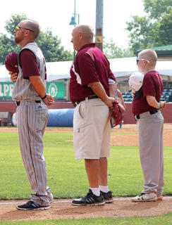 Head Coach Patrick Campbell, his father Eugene Campbell, and nephew/batboy Sy Bramblett stand side by side during the National Anthem.