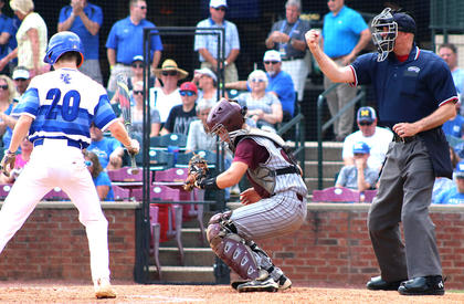 Catcher Cody Browning secures a pitch as home-plate umpire Todd Saxey calls strike three on the batter.