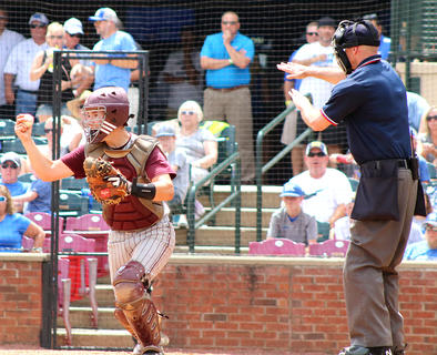 Catcher Cody Browning holds on to a foul tip for a strikeout as home-plate umpire Todd Saxey makes the call.