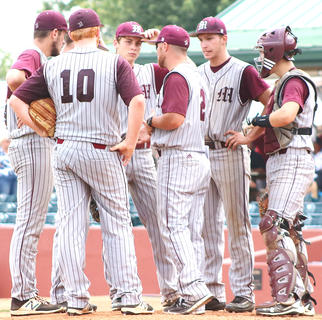 Head Coach Patrick Campbell confers with his infield in the sixth inning.