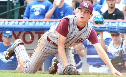First-baseman Luke Thomas makes a diving catch on the foul line for an out in the sixth inning.
