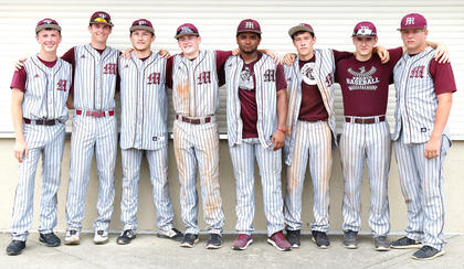 The Knights seniors gather for one last group photo. Pictured, from left, are Brandon Lee, Andrew Spalding, Landon Russell, Nicholas O'Daniel, Cameron Nalley, Dalton Hammond, Cody Browning and Luc Buckman.