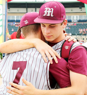 No. 7 senior Nicholas O'Daniel and junior Luke Thomas console each other after the season-ending loss in the state tournament semi-finals.