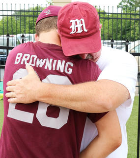 Senior Cody Browning and his father Mickey Browning embrace after Cody's final game as a Marion County Knight.