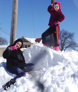 Brianna Thomas 12, and Brooklyn Thomas, 9, strike a pose in the snow.