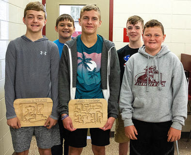 Students use computer aided design anddrafting to create wooden mazes. Pictured, front row from left, areMason McRay, Wes Tungate and Preston Spalding; back row from left are Kole Benningfield and Michael Gribbins. It's Time to Build Campwas held at the Area Technology Center June 3-5.