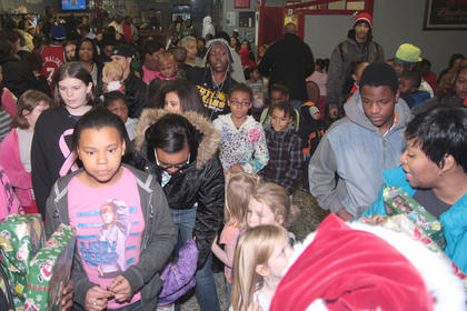 It didn't take long for the children to line up for their opportunity to visit with St. Nick.