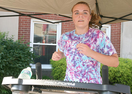 Chelsie Wright takes a turn on one treadmill ...