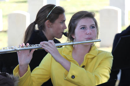 Emma Thompson plays the flute with the Marion County Marching Knights during the ceremony.