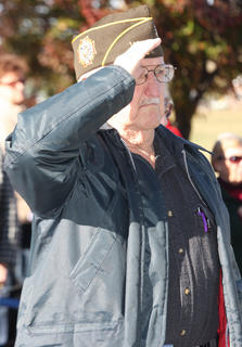 A local veteran salutes the flag during a Veterans Day ceremony at the Lebanon National Cemetery.